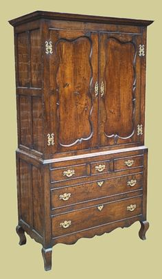 Clothes press, handmade in oak. French inspired, with shaped fielded panel doors, solid brass handles on cabriole feet. Oak Bedroom Furniture, Bedside Cabinet, Brass Handles, Panel Doors, Solid Brass, Cupboard, Armoire, Drawers, Handmade