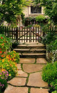 This is a very pretty pathway, leading to the house. I love the moss growing between the flagstone.