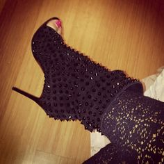 Evelyn Lozada shows off her Christian Louboutin studded open toe booties!