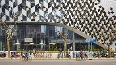 Tessellating diamonds create an intricate grid of solid and void across the facade of this shopping centre that Dutch firm UNStudio has completed in Shanghai.
