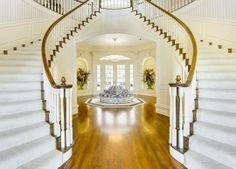 Inside the front door is a double curved staircase reminiscent of Scarlett O'Hara's mansion Tara. The staircase leads to five bedrooms, including a large master suite. The home also has a second stairway and an elevator. | 629 John Charles Drive in Burleson, Texas