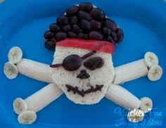 Fun Food. Pirate Lunch -   2 Pieces of Whole Wheat White Bread  Sliced Turkey  Sliced Cheese  1 Banana  A Handfull of Dark Grapes  A Small Handfull of Raisins  1 Red Fruit Roll Up