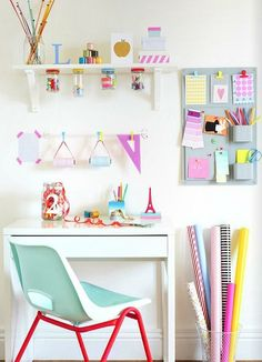 Colorful craft room ideas---really like the jars under the shelf...and the fun colorful chair!