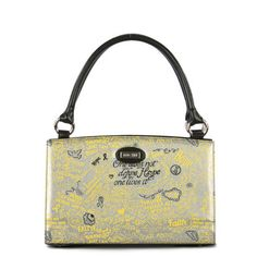 Hope (yellow) for Classic    The Hope (yellow) Shell for Classic Bags features yellow and black inspirational quotes from cancer survivors on silver faux leather background. The ultra-chic graffiti design is a Miche original .Know you are helping! A portion of ever purchase of the Hope Shell goes directly to cancer research     Base bag and handles not included.