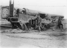 MINISTRY INFORMATION FIRST WORLD WAR OFFICIAL COLLECTION (Q 14794) Turkish gun at Sedd el Bahr, dismantled by Landing Party from H. M. S. IRRESISTIBLE, covered by Royal Marine detachment, February 1915.