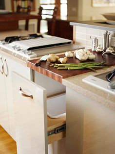 Trash can under the built in cutting board? Yes, please!