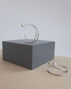 The new hoops in silver. This is the medium size super light weight to wear my take on the classic hoop earring! Handmade in Scotland.