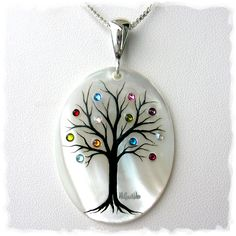 Your family tree hand-painted on a mother-of-pearl pendant with birthstone representation of each family member.