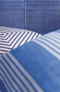 Ralph Lauren Paint's Indigo Denim finish, inspired by classic textiles, accessorized with blue and white throw pillows.