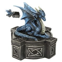 This dragon appears to be sleeping, but don't try to steal the treasures inside his box! The little guardian has a blue body and wings, with cream-hued horns and belly scales. The box upon which he rests, perfect for storing small treasures, is decorated with Celtic-inspired knot designs. This would make a great gift for a dragon lover!