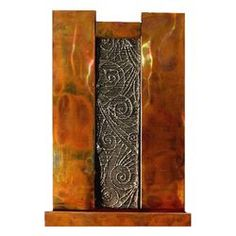 Meteor Shower Wall Fountain This stunning copper metal fountain draws its inspiration from the night sky. Two cubic pillars create a dramatic frame for the metal casting design in the center. Indoor Wall Fountains, Indoor Fountain, Water Fountains, Fountains For Sale, Copper Wall, Copper Metal, Les Cascades, Meteor Shower, Metal Casting