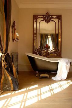 A freestanding claw-foot bath, gilt mirrors and floor-to-ceiling curtains create a romantic bathroom escape and a sense of decadence. Luxury Hotel Bathroom, Bathroom Interior, Hotel Bathrooms, Luxury Bath, Romantic Bathrooms, Beautiful Bathrooms, Modern Spaces, Modern Room, Floor To Ceiling Curtains