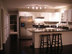 Cabinet color, wainscotting, black countertops
