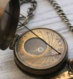 -Vintage brass pocket compass sundial, reproduction.