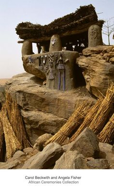 Africa | The Toguna house, decorated with relief images of masked dancers, is the meeting place for male elders. Dogon people, Mali.  | ©Carol Beckwith and Angela Fisher