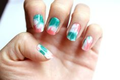Marbled sea green, coral, and white nails
