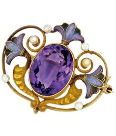Egyptian Revival Amethyst, Lotus Leaf Motif Enamel and Gold Brooch, American, Circa 1900. Included in the Egyptian Revival Exhibition at SJ Shrubsole. #EgyptianRevival #brooch