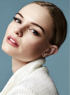Kate Bosworth looks flawless with a sleek center part low chignon and full lashes for Marie Claire UK shot by David Roemer