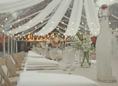 Love the ceiling draping with white lights.  Not so much a fan of the table decor.