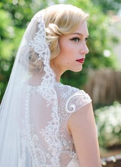 Love the hair and veil! :) Retro waves, cat eye liner, and a perfectly defined red lip compliment a classic lacy veil. #retro #glam via Wedding Sparrow UK- Lover.ly