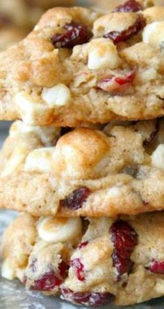 Oatmeal Cranberry White Chocolate Macadamia Chip Cookies ~ Loaded with dried cranberries, crunchy nuts and sweet white chocolate chips... They are everything a great holiday cookie should be!