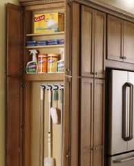 "All you need is a sliver of space--in this case just a 6""-deep cabinet appended to the pantry adjacent to the fridge--to carve out a handy broom closet for storing cleaning supplies. Via TheHomeDepot.com"