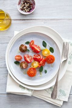 Simple delicious for summer: tomatoes with olive oil, oregano, salt and pepper.