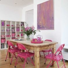 pink folding chairs get added weight from wall of pink accents.  Living etc.