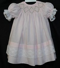 Smocked bishop dress, love the wide lace at the bottom and the large diamonds really stand out on the smocking, this SmugMug site has 100's of photos of heirloom garments