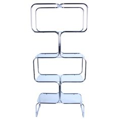 View this item and discover similar for sale at - Sculptural Italian chrome and glass etagere by Tricom. One shelving unit retains label.(pair available) Glass Furniture, Nesting Tables, Console Table, 1970s, Chrome, Sculpture, Studio, Home Decor, Decoration Home