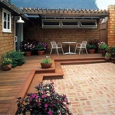 Like this low deck that transitions to the patio. by ila