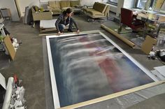 Large-format photographic art is one of Isabella Trimmel's artistic mediums. Isa, getting ready for an art-exhibiton. Find more at www.art-y-sana.com