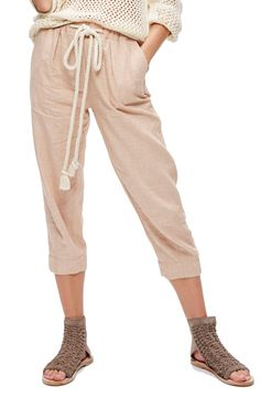 everyday drawstring pants by Free People. Woven in a luxe blend of cotton and linen, these easygoing cropped pants are pressed with crisp pleats and cinched wi. Pleated Pants, Harem Pants, White Cropped Trousers, Comfy Pants, Drawstring Pants, Pull On Pants, Feminine Style, I Love Fashion, Spring Summer Fashion