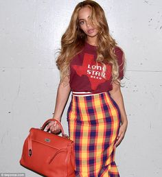 State of mind:The Grammy winner paid a nod to her native Texas as she was dressed in a red 'Lone Star Beer' T-shirt that featured the state's silhouette