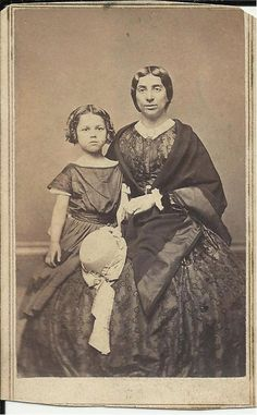 1860s CDV of a woman with a child with tax stamp on back, unusual blanket type shawl and straw hat with ribbon decoration