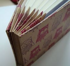 A book spine that I can slide postcards into & out of. Or some other clever way of during them...