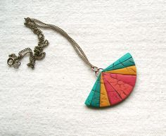 Modern oriental fan necklace geometric polymer clay faux leather pendant necklace turqoise blue teal sunny yellow warm pink rainbow pendant