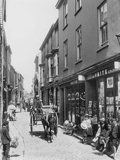 St. Ives, Cornwall - A view of the entrance to Fore Steet. Devoid of cars, but even then the street was narrow enough to cause congestion with horse drawn transport.  From the costume it would appear to have been taken in the Edwardian era or just before WWI.