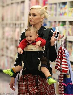 Gwen Stefani takes her boys Kingston, Zuma and Apollo shopping on December 6, 2014