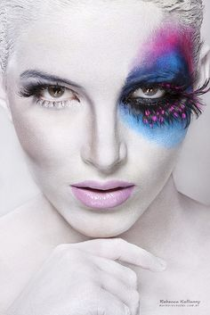 Colorful fantasy #eyemakeup on left eye - blue, fuscia and black eyeshadow topped off with dramatic feather false eyelashes!