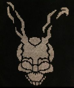 Frank from Donnie Darko cross stitch by Emma Gough.