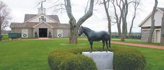 A monument to the great racehorse Seattle Slew stands in front of the stallion barns at Three Chimneys Farm, which consists of 2,300 acres and offers boarding, marketing and breeding services to Thoroughbred owners.  |  Barbara Duckworth photo