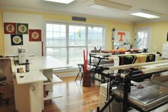 Kathy Drew's longarm quilting studio ... love the windows for all the natural light.