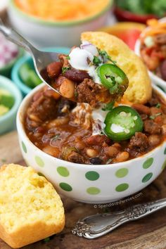 15 Bean Slow Cooker Chili is perfect game day food! When serving a crowd, we make this chili ahead of time and serve with toppings for guests to customize!