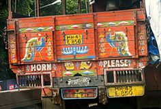 peacock painting on back of truck
