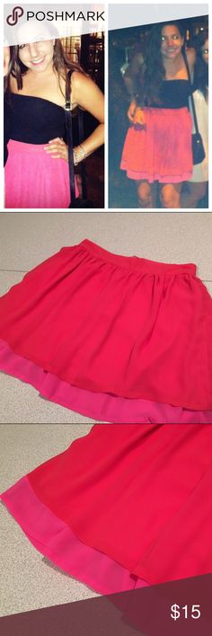 """H&M / hot pink and red skirt Super cute hot pink skirt with red layer on top. Great for the summer with a black or white shirt tucked in. Sizing: H&M size 8 which comfortable fits someone who is a 26/27 in jeans. High waisted fit. Approx 14.5"""" across. Length: approx 16.5"""". Material: 100% polyester. H&M Skirts Mini"""