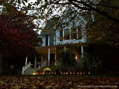Our Victorian front porch, decorated for Halloween. Mason jars and lights