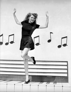 Rita Hayworth dancing on giant piano keys. Description from pinterest.com. I searched for this on bing.com/images