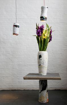 Sconces, vase, table made from recycled paper. Amazing.