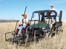 Accessibility for those who are in a wheelchair may not be very easy if they enjoy hunting. This image shows a motorized vehicle with an attached sitting area for those that are in a wheelchair making it easier for them to get to a hunting area.